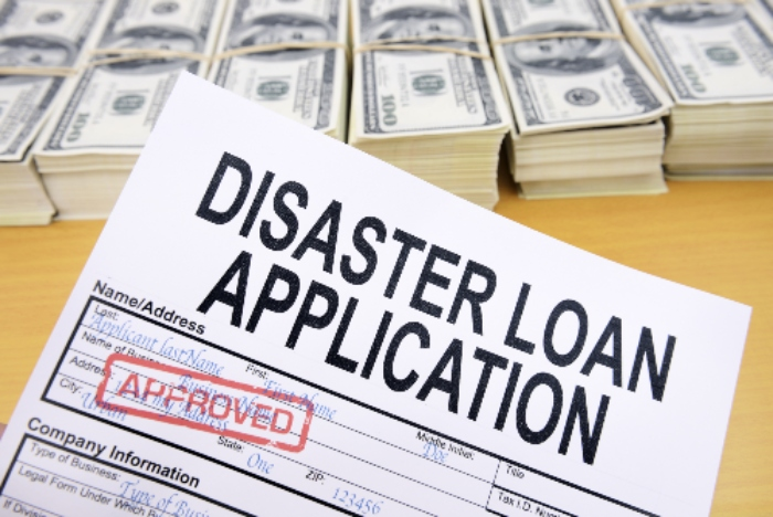 Many small businesses can get cash like that in this picture by completing a disaster loan application.