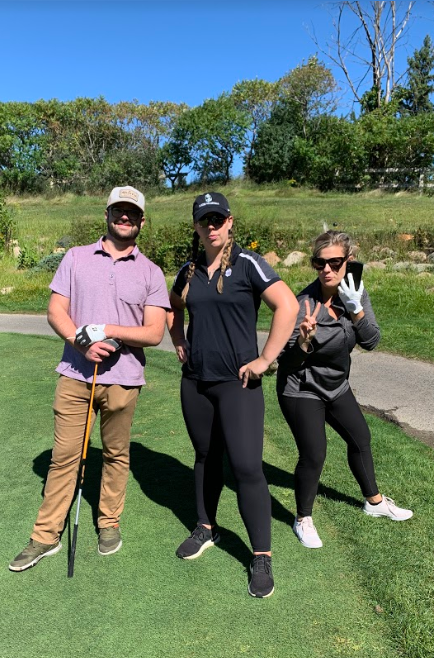 A team pose during the golf outing - still working!